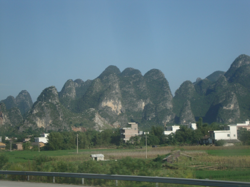 Villages around karst peaks, on the bus to Yangshuo